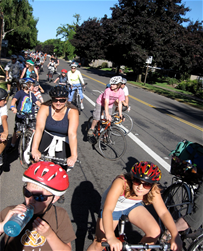 Large group of people biking together on the road
