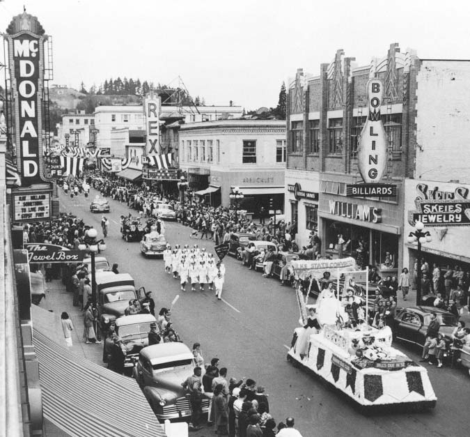 Historic photo of a parade down a Eugene street