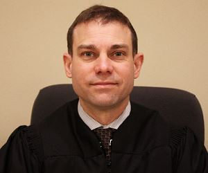 Associate Judge Greg Gill
