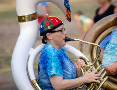 Woman on tuba celebrating at a EUGfun event