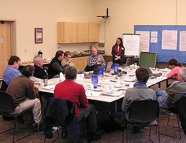 board members working around a large table
