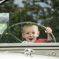 Boy behind the wheel at Touch a Truck