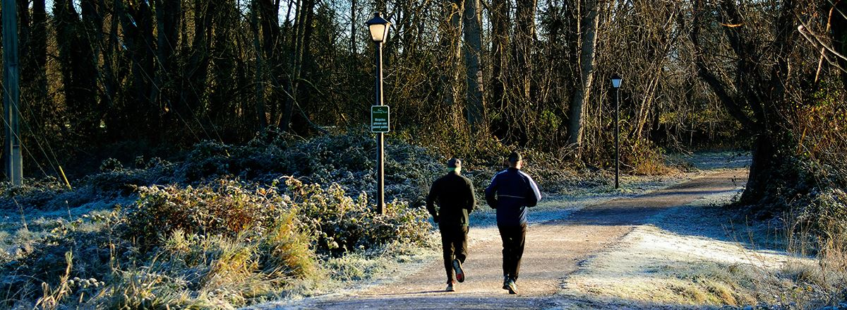 Two men running on Pre's Trail on a frosty morning