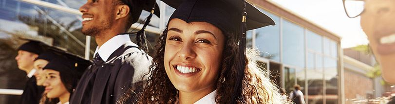 graduating student smiling with mortarboard