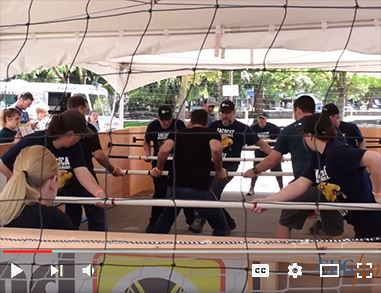 Photo link to Human Foosball webpage with video of a human foosball game