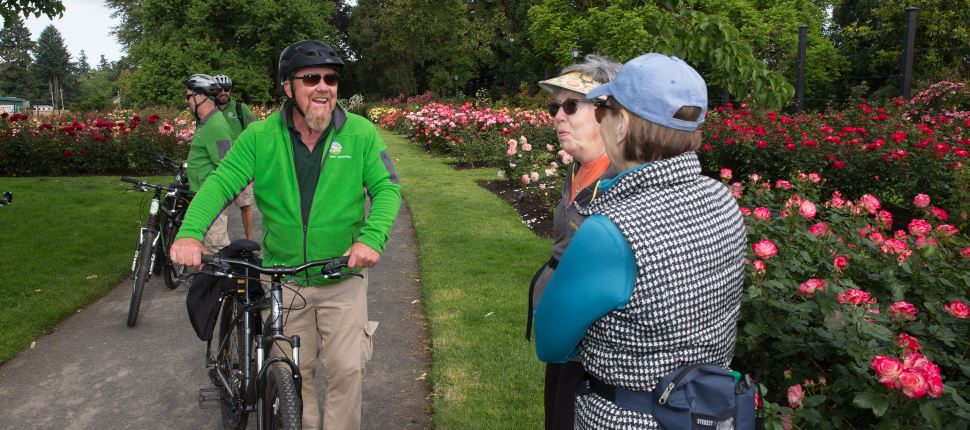 park ambassador talking to two women on bike path
