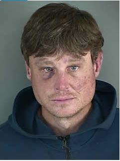 Forrest Wayne Sims, age 40, arrested for assaulting an officer