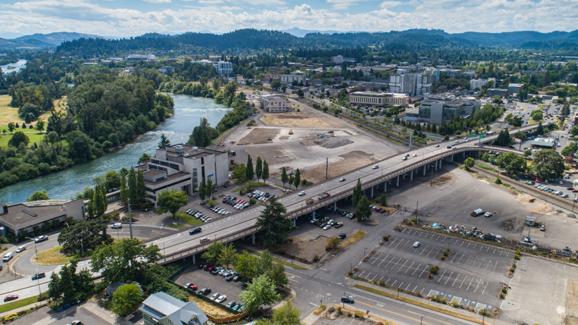 Aerial drone photo of the riverfront site, looking south east from the general area of 4th and Mill