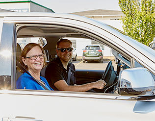 Mayor Vinis and Matt Sayre, Technology Association of Oregon, take one of the first Rideshare rides.