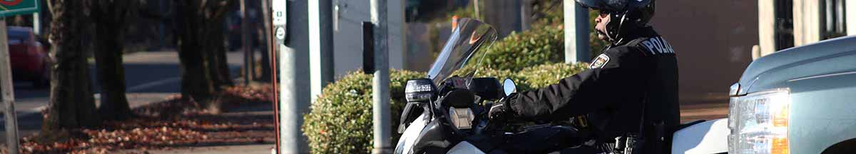 Police Officer patrolling on a motorcycle
