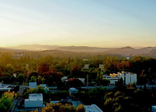 Hazy sunset over City of Eugene