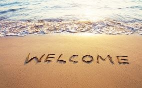 Welcome written in the Sand