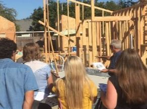 Observers tour a tiny home village under construction