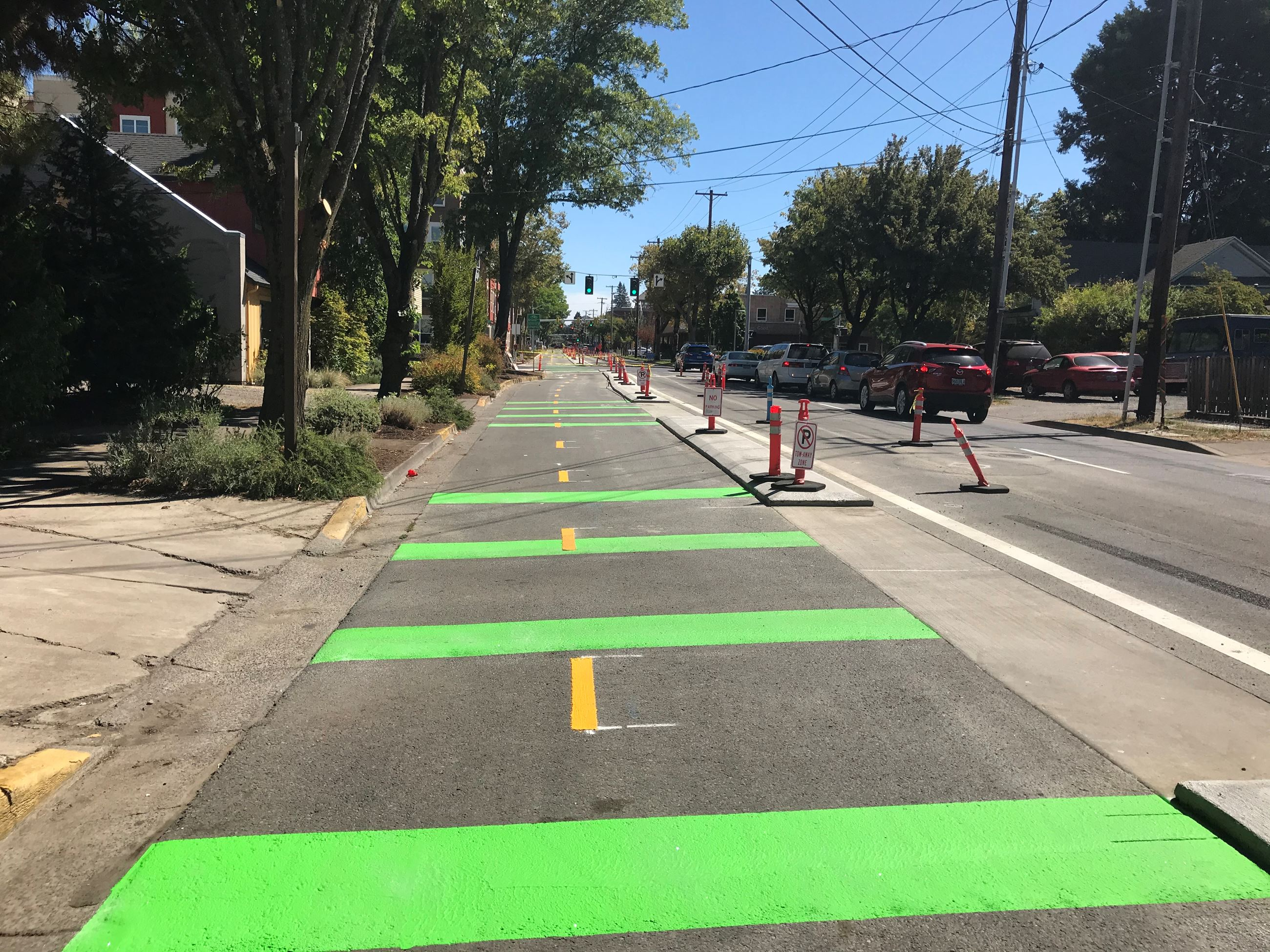 13th Avenue Bikeway. Green painted two-way protected bike lanes.