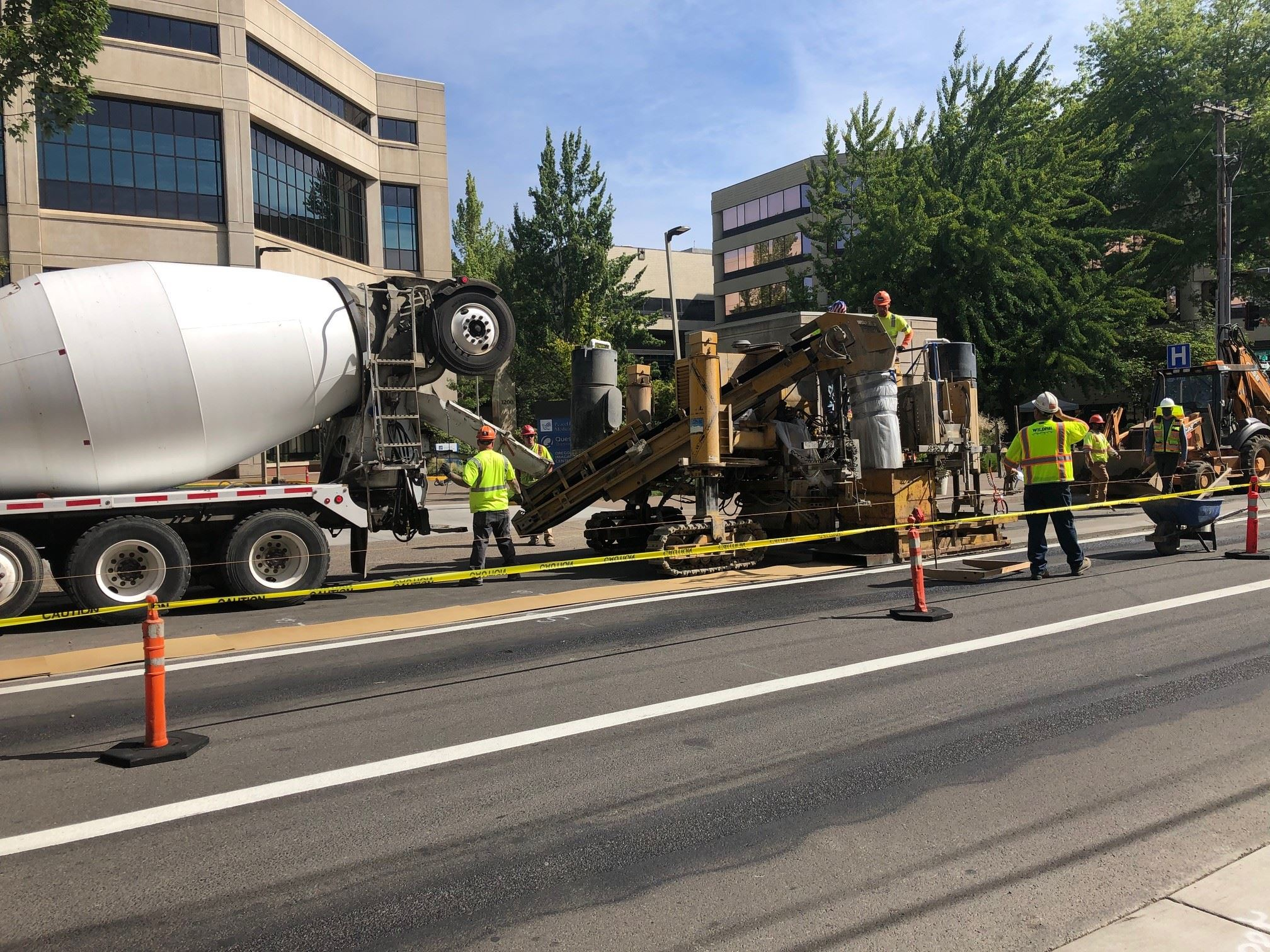 13th Avenue Bikeway concrete divider being poured.