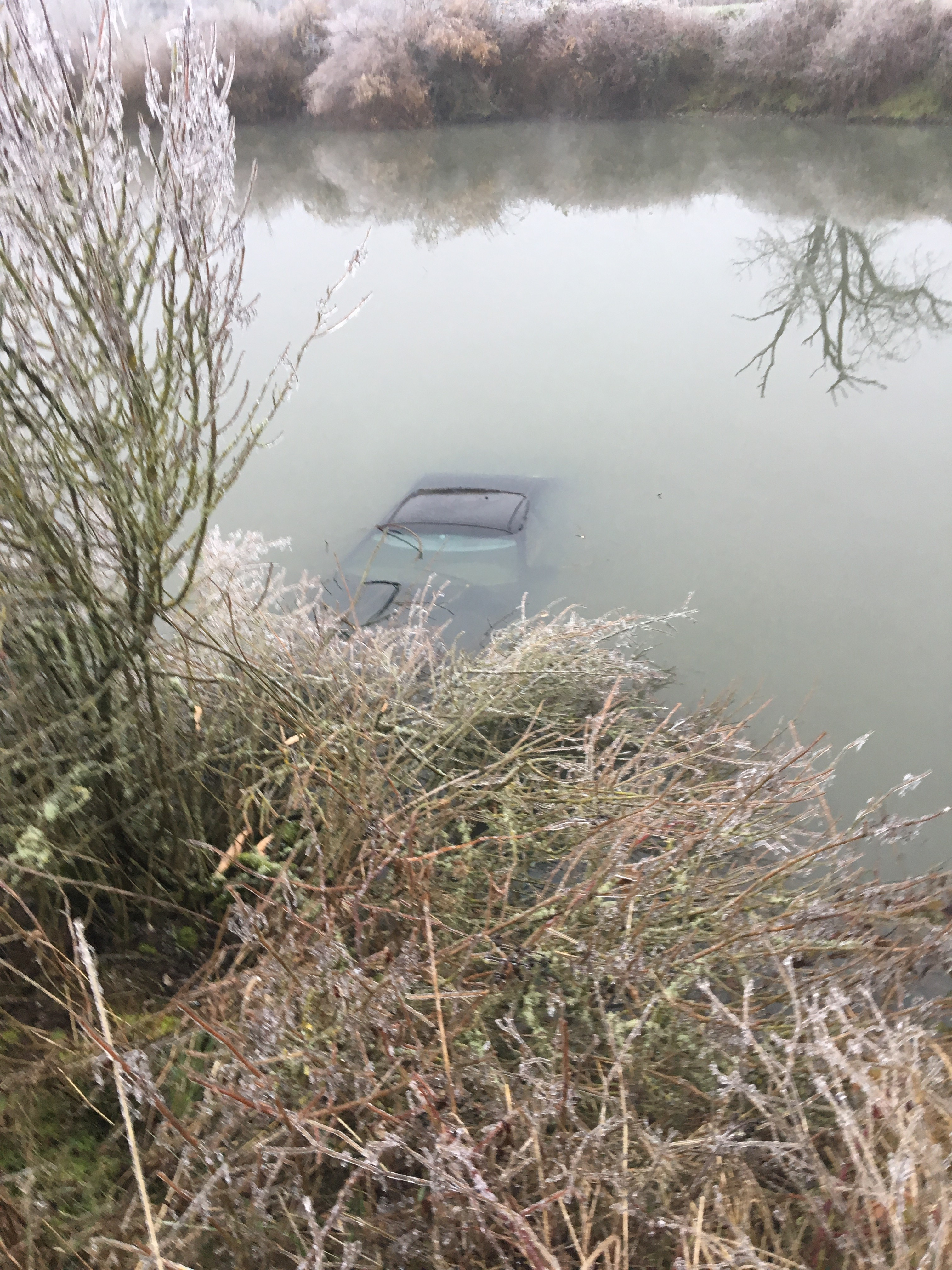 UPDATED: Three bodies found in submerged car; community in ... |Submerged Car