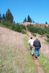 Two people hiking a trail